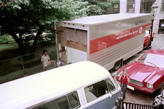 71-099 (ndpa / s. lundeen, archivist) Tags: nick dewolf nickdewolf color photographbynickdewolf 1975 1970s film 35mm 71 reel71 boston massachusetts beaconhill dewolfhome 3mtvernonsquare truck movingtruck uhaultruck vw volkswagen bus microbus car vehicle automobile ford mustangii mustang teddypierre tree fence chainlinkfence furniture loadedtruck load themove moving boxes boy girl pierre vanessa lamppost summer july