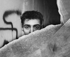 Hideout (rob kraay) Tags: portrait shelter bw decomposedbuildingmaterial robkraay blackandwhite people