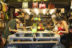 The travelers enjoying the hand made bags (Sittipol Mahapirom) Tags: shop bag tourists travelers handmade street market photography business handbag colorful night life lifestyle people bags nikon nikor d80