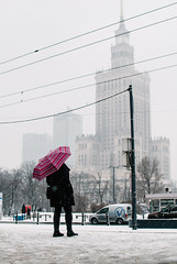 It snowed. (ewitsoe) Tags: city nikon street warszawa winter erikwitsoe erikwitsoecom poland snow urban warsaw snowing umbrella pedestrian cold palaceofcultureandscience tram stop lady woman travel traveler metro