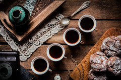 Coffee hour. (jakub.sulima) Tags: nikon d750 nikkor 50mm 18 indoor inside studio stilllife food eat edible rustic retro old vintage weathered wood wooden table tableware lace tray teaspoon cup clock desk camera book coffe cookies sweets candy sugar home window light natural cosy pastel delicate warm colours brown silver gold grey white blue aqua teal green yellow turqoise ad advert homemade baked goods espresso cavallucci italien italy dof texture leisure relax winter autumn november