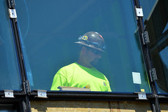 A construction worker assembles a window in the Center for Engineering, Innovation and Sciences on a sunny May afternoon. (Wentworth Institute of Technology) Tags: cap clothing face hardhat hat head helmet human person portrait