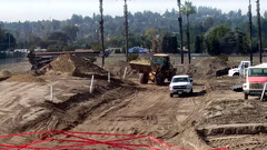 (Rich T. Par) Tags: pomona phillipsranch socal southerncalifornia losangelescounty lacounty constructionsite california palmtrees tree road suburb dirt civilengineering tubes tractor heavyequipment pipes sky watertruck frontloader drill drillingmachine drillingtruck