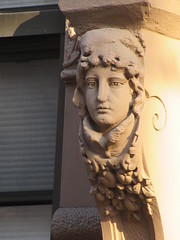 Woman with High Collar Gargoyle Next to Door Way 4850 (Brechtbug) Tags: woman with high collar gargoyle next door way front exterior building entrance new york city near 9th ave west 21st street nyc 2018 gargoyles statue sculpture man portrait art downtown stone terracotta tile artist portraits 20s area w women slope low nose november 11122018