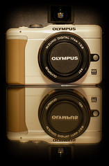 Olympus E-PL1s. . . (CWhatPhotos) Tags: cwhatphotos photographs photograph pics pictures pic picture image images foto fotos photography artistic that have which contain olympus epl1 pen original colors colours black white silver bodycap lens body three together red camera epl1s view finder add vf1 one viewfinder zuiko 17mm prime