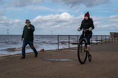 L1015674 (Camera Freak) Tags: 190308englandm10leicam10englanduk2019march seaside cyclist bicycle pennyfarthing rider sea beach beachfront windy leica m10 50mm summilux hunstanton norfolk