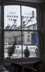 Calne (thulobaba) Tags: wiltshire calne england snow winter cafe window view outside divineonthegreen restaurant cakes coffe tea