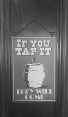 Tap it. You know you want to. (Veee Man) Tags: gimp bw blackwhite wall bar albuquerque newmexico boxingbearbrewing cellphone lgls997 sign humor barrel triangle rectangle words seven 7 alcohol liquor