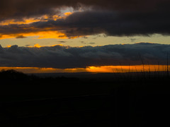 God is Hiding Behind the Clouds because he/she is upset at what we have done to the planet! (RS400) Tags: sun set sunset clouds wow cool amazing wicked landscape orange yellow ark dark art sky travel uk southwest photography olympus zoom lens