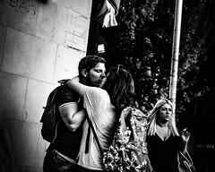 Those who have (Kieron Ellis) Tags: man woman people embrace kiss smoking wall pole candid contrast street blackandwhite blackwhite monochrome