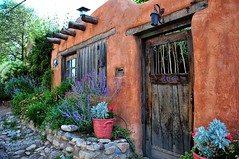 adobe house, New Mexico (Bluescruiser1949) Tags: adobe newmexico santafe flowers colorful privacy wall