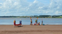 imminent launch (Ultrachool) Tags: beach people water sand kayaks kayaking princeedwardisland clouds unlimitedphotos cans2s