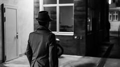 The detective (ramvogel) Tags: sony a6300 sigma30mmf14 sigma street streetphotography blackwhite bw night zürich