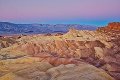 Zabriskie Point at Dawn (Alan Amati) Tags: amati alanamati america american southwest california desert mojave zabriskie point death valley deathvalley np national park formation mountains sunrisr dawn firstlight morning morninglight earlymorning early earlylight winter landscape sandstone rock trail path soft light lookingwest nature natural beautiful breathtaking grand vista view viewpoint overlook topf25 topf50 topf100 topf200