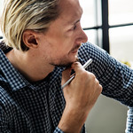 Blond man busy at work thumbnail