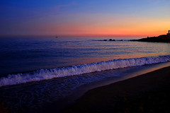 In the meanwhile during the nightfall (Fnikos) Tags: sea water mar mare seascape waterfront wave ola rock boat sailboat landscape beach sand shore seashore coast sky skyline dusk atardecer outdoor