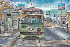 Seasonal Streetcar (Gunn Shots (On and off these days)) Tags: tram streetcar sandiego 1078 sanfrancisco newjersey 1946 shadows dirtycity litter