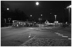 tram no. 2 to central railway station (juhanflick) Tags: nikonfe nikkor35mm apx100 rodinal 125 bw helsinki nightshot