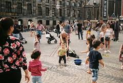 Amsterdam,Netherlands (aqawitt) Tags: amsterdam ams dam street snap streetphotography shootfilm shooting dutch film filmphotography fm2 holland iro200 irofilmneverdie nikon netherland nikonfm2 nikkor negative 35mm kid