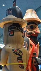 VERY BEAUTIFUL LARGE  WESTCOAST TOTEMS.  THESE WERE NEW ADDITIONS TO THE VANCOUVER AIRPORT. BC. (vermillion$baby) Tags: nativeart airlines airport art carvng color firstnations haida totem vancouver westcoast wood artsculpture native pacificnorthwest artofnorthamerica artofnativenorthamerica museum carving sculpture woodcarving museums artofthenative nativeamerican indian gallery vivid aborigine