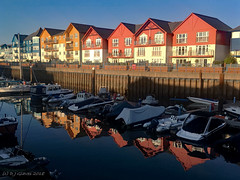 Marina reflections (ExeDave) Tags: exmouth marina east devon sw england gb uk coastal harbour landscape waterscape moored boats exe estuary buildings houses apartments reflections december 2018 cameraphone iphone