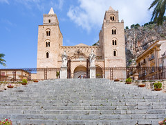 medieval norman Cathedral in Cefalu, Sicily (chrisdingsdale) Tags: duomo cathedral basilica norman cefalu tower facade front statue sculpture gate wicket door pass entrance tourist landmark famous sightseeing antique sicily italy old medieval style church temple outdoor urban square way palace cathedralbasilicaofcefalu duomodicefalu sky blue summer day italian architecture sicilian view site town step stair column pink sicilia southern christian roman catholic