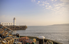 Scarborough lighthouse and lobster pots. (jack cousin) Tags: scarborough yorkshire northsea sea seascape coast coastal shore seashore seaside waterfront water skyline horizon headland promontory trees building outdoor nature holiday vacation resort sky cloud tranquil serene peaceful lobsterpots crabpots mesh frame lighthouse bollard capstan quay jetty pier nets fishingnet buoy tyre rubbertyre wood paraphernalia statue memorial nikond610