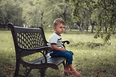 Nr. 2 (OlegS82) Tags: park portrait boy child children childhood green trees bench canon500d ef40mmf28 sad naturallight nature outdoor family