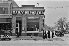 Home Daily: Street scene in Spencer, Iowa, December 1936. (polkbritton) Tags: russelllee 1930s streetphotography fsaowi libraryofcongresscollections classiccars iowahistory vintagefashion