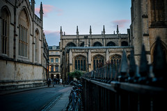 Oxford at Dusk (Electra_star) Tags: oxford street cityscape city dusk sunset architecture buildings fence bicycles cityofdreamingspires nikon england vscofilm