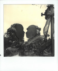 Vancouver Lovers (gooey_lewy) Tags: vancouver lovers statue padlock art display interactive canada key heart lover love intimate polaroid sx70 instant film photo photography sx 70 road sky black white mono people locked