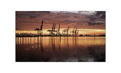 Industrial Sunrise. (muddlemaker1967) Tags: hampshire landscape photography southampton docks cranes lights clouds sunrise reflections colours fujifilm xt1 fujinon xf 1855mm f284 r lm ois