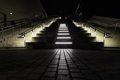 light on staircase (Rudy Pilarski) Tags: staircase nikon nuit night nb nikkor line ligne light lumière luz escalier pavée moderne modern rail railway paris la seine musical france francia europe europa structure urban urbain urbano city ciudad ville
