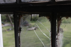 A broken window with a nail sticking out within the Dr. Calvin M. Baber Historical Home. Hillman has been restoring the house for over two decades yet has had some difficulties financially supporting this endeavor.