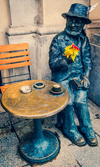 Sculpture (Piotra Skryneckiego) Market Square - Krakow Old Town (Cross Process Effect) (Fujifilm X100F Compact) (1 of 1) (markdbaynham) Tags: krakow cracow poland polish polishcity pl europe europeancity city cityscape citybreak highendcompact historicplace historiccity medievalcity medievaltown vacation fuji fujifilm fujista fujinon fujix x100f fujifilmx100f transx transxsensor compact apsc 23mm f2 primelens prime oldtown staremiasto fujifilmtransx