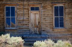 Knock Three Times (nedlugr) Tags: california ca usa bodie bodiestatehistoricpark ghosttown windows door steps weatheredwood weathered ruraldecay ruralwest reflections sagebrush