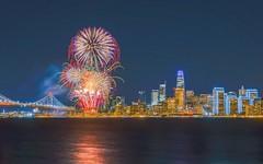 New Year Fireworks (Naveen Kola) Tags: bayridge bridge newyear ocean neon lights skyscraper building water blue sky travel fireworks sf night bay skyline