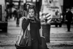 On the Grand Parade (Frank Fullard) Tags: frankfullard fullard candid street queenofsheeba grandparade grandentrance tiara lady cork irish ireland monochrome black white blanc noir mobile telephone phone shoulder bag shoulderbag hair