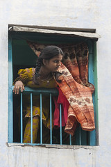 Looking on the street (Dick Verton ( more than 12.000.000 visitors )) Tags: india varanasi girl asia traveling streetimage streetscene streetview window looking