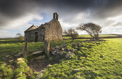 Solitude (Ffotograffiaeth Dylan Arnold Photography) Tags: church abandoned sunshine grass green trees hawthorn ancient farmland rural field derelict building holy remains wales anglesey ruin ruined sky clouds sunlight darkclouds stones rocks medieval shadows hiddenwales landscape cymru yellow winter bucolic pastoral ecclesiastical history historic outside outdoors canon canon1635mmf4l vanguard benrofilters circularpolarizer ndgrad canon6d