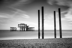 Silent corrosion (Through_Urizen) Tags: architecture brighton category decay eastsussex england external longexposure places seascape westpier blackandwhite whiteandblack bw monochrome mono ruin rust derelict corrosion ruins metal structure steel waves beach pebblebeach sky cloudysky whiteclouds pebbles stones breakingwaves canon70d canon1585mm canon outdoor travelphotography landscapephotography landscape englishchannel uk unitedkingdom greatbritain