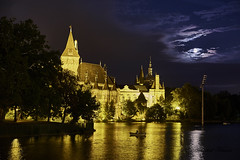 Vajdahunyad Castle (abhishek.verma55) Tags: vajdahunyadcastle hungary budapest travelphotography ©abhishekverma light lake flickr photography fujifilmxt20 serene beautiful castle moon moonlit clouds cloudy cloudscape landscape travel vajdahunyadvára tranquil lakeside boat architecture beauty colourful colorful moody europe eurotrip famousplaces landscapes outdoor outdoors lights outside steeple scenic scene urban urbanlandscape vacation view wanderlust water exploration landmark monument peaceful romantic architecturelover beautifulsky