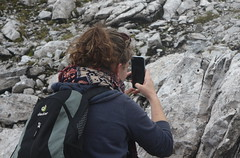 "Photograher taking picture of small mound of arranged stones ""heap-of-stones"" up a mountain near Innsbruck Austria (Jet737) Tags: photograher taking picture small mound arranged stones heapofstones up mountain near innsbruck austria"
