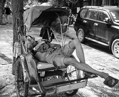 A Quick Nap on a Hot Day (jbrad1134) Tags: cycle bike bicycle bw blackandwhite steel streets street sleep midday hot candid cambodia phnom penh asia southeastasia travel adventure