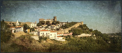 Medieval Obidos(Portugal) (williamwalton001) Tags: pentaxart texture trees timber tones colourimage church town hillside castle portugal medieval fineart buildings
