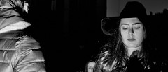 Eyes wide shut. (Baz 120) Tags: candid candidstreet candidportrait city contrast street streetphotography streetphoto streetportrait strangers rome roma europe women monochrome monotone mono noiretblanc bw blackandwhite urban life portrait people italy italia grittystreetphotography flashstreetphotography faces decisivemoment