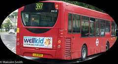 Route 397 Friday Hill (M C Smith) Tags: bus red route 397 pentax k3 chingford fridayhill poster advertising letters numbers symbols lines zigzags car white lamps building trees grass silver yellow orange reflections busstop busshelter bins
