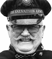 Salvation Soldier (Wilamoyo) Tags: portrait smile man elderly moustache face glasses specs hat salvation army peak cap