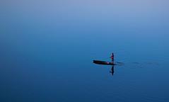 The lonely boatman (kabirshadrukh) Tags: boatman boat nature landscape beautiful alone loneliness allalone minimalistic blue colors vibrant lifestyle streetlife people