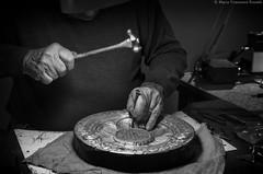 Craftsman at work _IGP9601_cr_ps_sat_bnw_w (shammuramat (on/off sorry, be bk soon)) Tags: craftsman master artisan metal work art hand craft craftsmanship handcraft florence firenze man artsandcrafts bnw blackandwhite bw blackwhite monochrome mono pentax pentaxk30 pentaxart shadow light